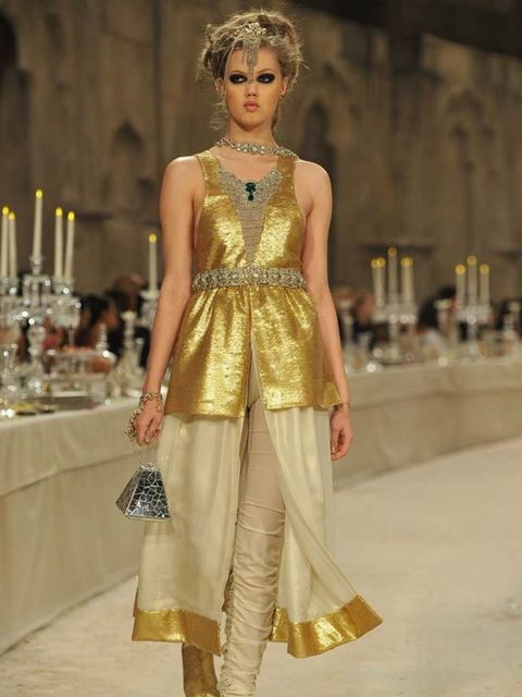 "<p><a href=""http://www.elleuk.com/catwalk/models/new-model-faces/(section)/a-w-2011/lindsey-wixson"">Lindsey Wixson</a> modelled a gold sari-inspired ensemble in Chanel's pre-fall 2012 collection.</p>"