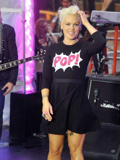 <p>Pink wearing a Markus Lupfer slogan sweater</p>