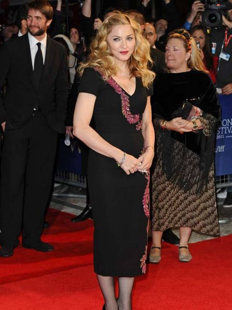 "<p><a href=""www.elleuk.com/starstyle/style-files/(section)/madonna"">Madonna</a> in <a href=""http://www.elleuk.com/catwalk/collections/l-wren-scott/"">L'Wren Scott</a> at the London Film Festival 2011</p>"