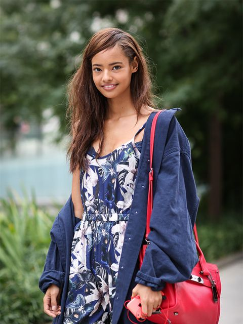 Malaika Firth wears Topshop coat and jumpsuit and Coach bag.