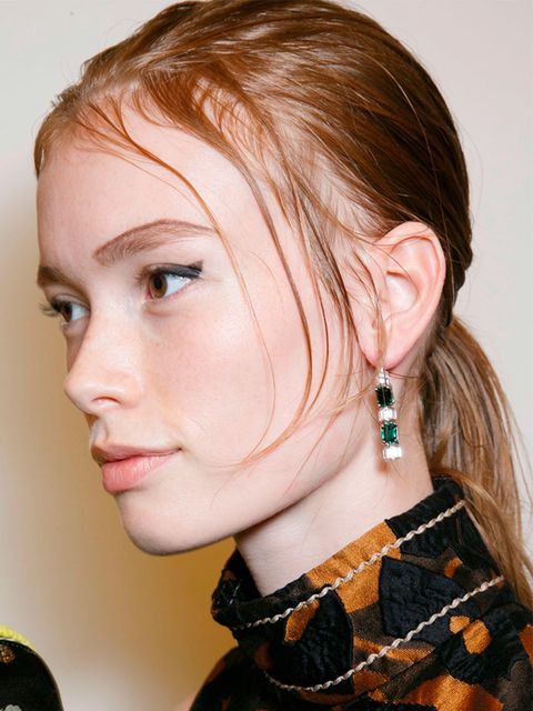"<p><a href=""http://www.elleuk.com/catwalk/prada/spring-summer-2015"">Prada </a></p>  <p>The look: Tough ponytail</p>  <p>Hair stylist: Guido</p>  <p>Key products: Redken Diamond Oil Spray (out Dec) and Mess Around 10 Cream-Paste, £11.16 at <a href=""http://"