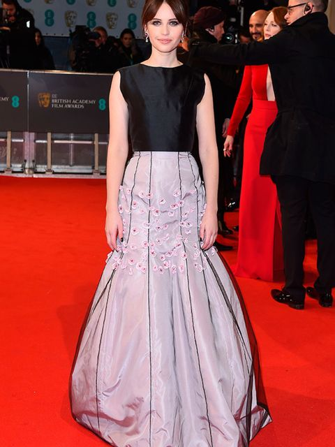 <p>Felicity Jones wears Dior to the EE BAFTA British Academy Film Awards in London, February 2015.</p>
