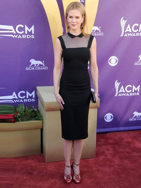 <p>Nicole Kidman wears a fitted sleeveless dress with a shirt collar and a sheer yoke from L'Wren Scott's Autumn Winter 12 collection to the Country Music Awards.</p>