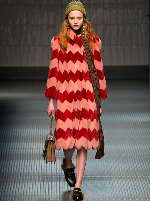 <p>GUCCI</p>  <p>From the multicoloured coat to the fur-trimmed loafers and bobble hat, this look sums up the new poetic mood at Gucci perfectly. AMC</p>