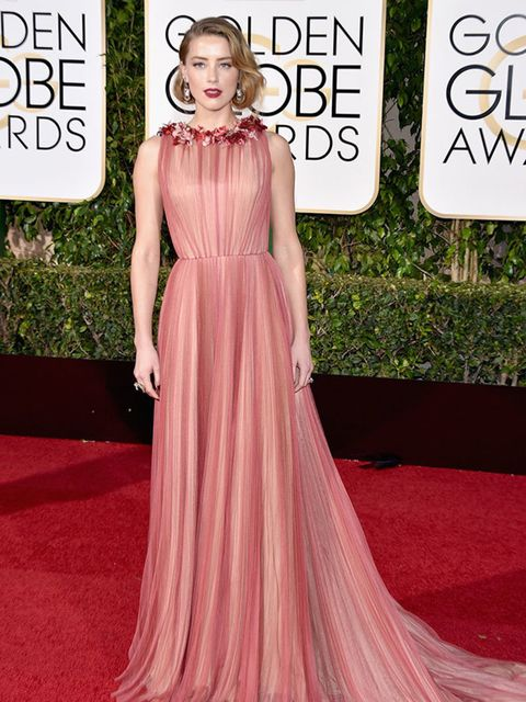 <p>Amber Heard in Gucci, attends the Golden awards in LA, January 2016.</p>