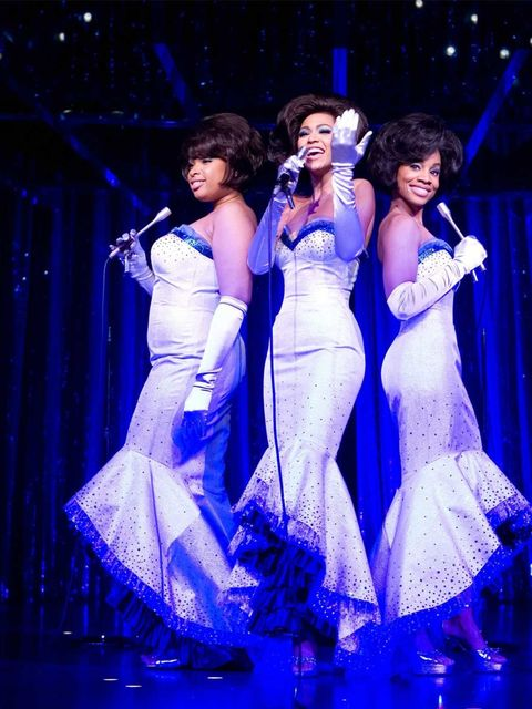 <p>Beyonce wears a silver concert gown and satin gloves designed by Sharen Davis in 'Dreamgirls'.</p>