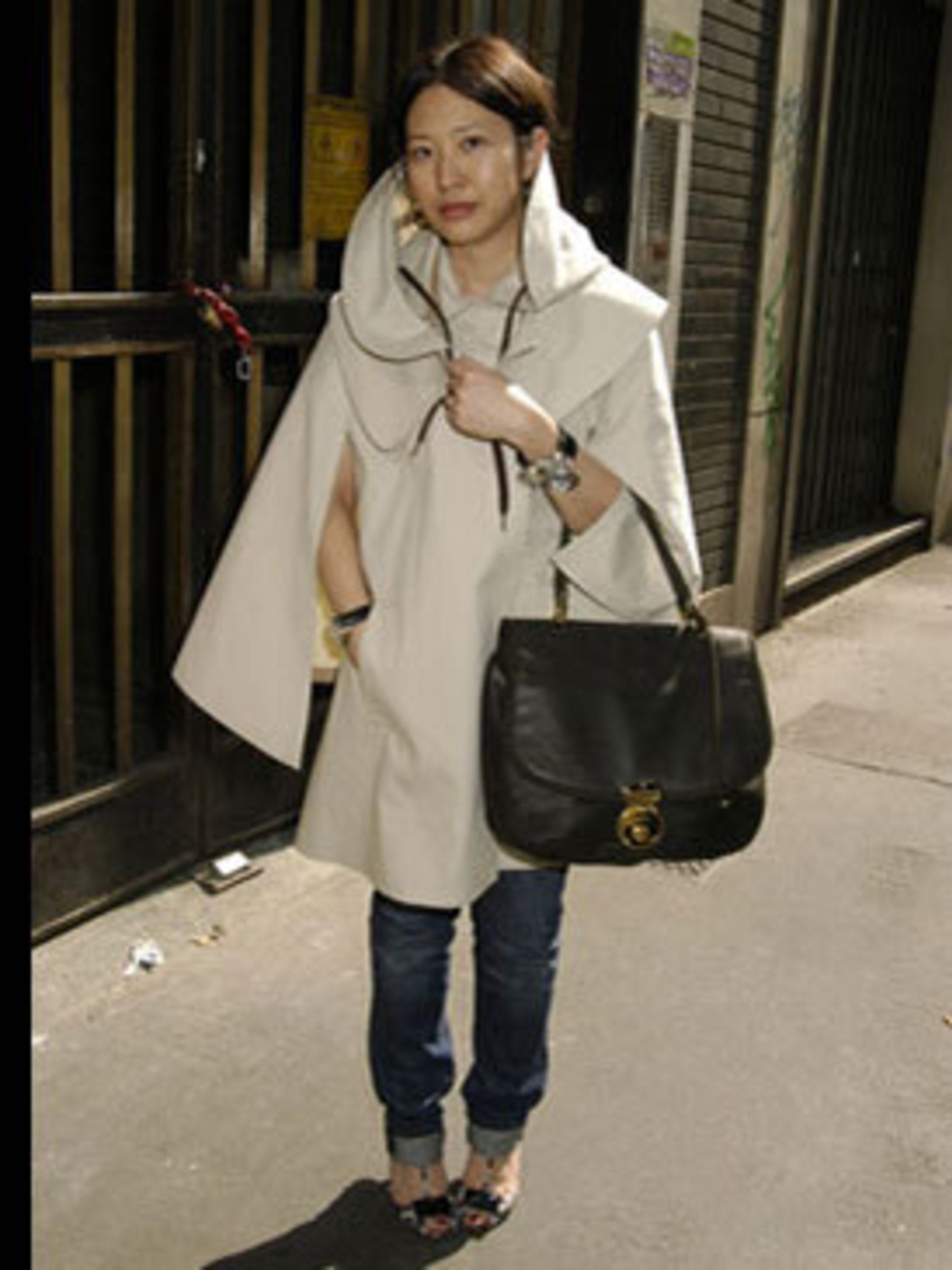 <p>Capes are big news this season and we love this Balenciaga bag.</p>