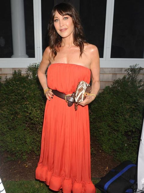 """<p><a href=""""http://www.elleuk.com/starstyle/celebrity-trends/(section)/everyone-s-wearing-bikinis/(offset)/12/(img)/702625"""">Tamara Mellon</a> attends the 12th annual Art For Life Benefit Gala at Russell Simmons' estate in East Hampton, NY on Saturday, Jul"""