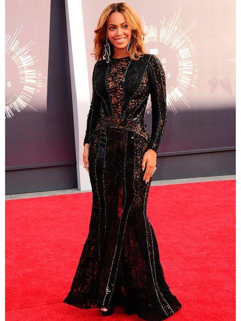 <p>Beyoncé wears a Nicolas Jebran dress, Christian Louboutin heels and Lorraine Schwarz jewellery.</p>