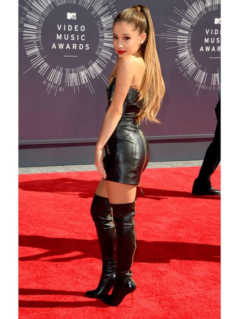 <p>Ariana Grande wears a Moschino dress and Tom Ford boots.</p>