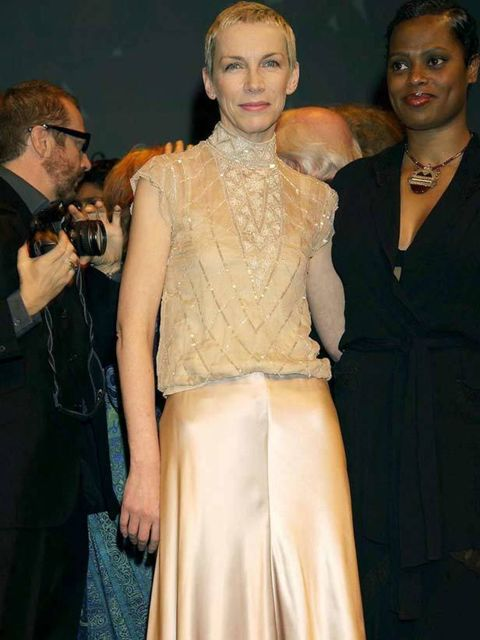 """<p><a href=""""http://www.elleuk.com/content/search?SearchText=Annie+Lennox&SearchButton=Search"""">Annie Lennox</a> at a gala evening for 'When Love Speaks Its Name' at the Old Vic, London, February 2002</p>"""