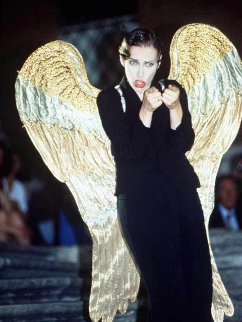 """<p><a href=""""http://www.elleuk.com/content/search?SearchText=Annie+Lennox&SearchButton=Search"""">Annie Lennox</a> rocks a trouser suit with wings performing with The Eurythmics in Rome, in 1992</p>"""