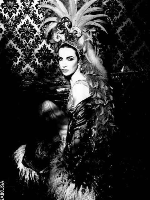 """<p><a href=""""http://www.elleuk.com/content/search?SearchText=Annie+Lennox&SearchButton=Search"""">Annie Lennox</a> poses for the camera in burlesque garb in 1991</p>"""