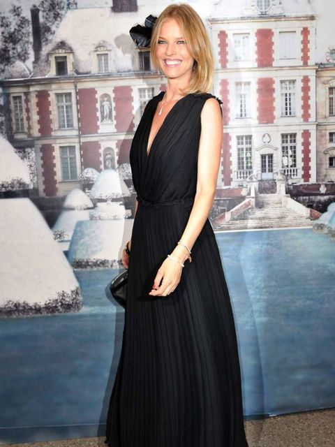 """<p><a href=""""http://www.elleuk.com/content/search?SearchText=eva+herzigova&SearchButton=Search"""">Eva Herzigova</a> goes for a plunging neckline number at the White Fairy Tale Love Ball in France, 6 July 2011</p>"""