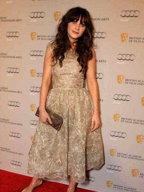 "<p><a href=""http://www.elleuk.com/starstyle/style-files/(section)/zooey-deschanel"">Zooey Deschanel</a> took to the red carpet in <a href=""http://www.elleuk.com/catwalk/collections/oscar-de-la-renta/autumn-winter-2011"">Oscar de la Renta</a> at the BAFTA Br"