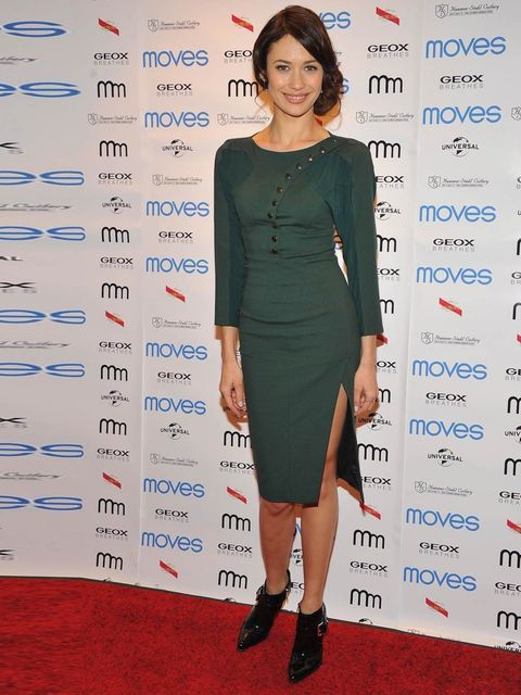 "<p>Olga Kurylenko attends the 2013 Moves Magazine Spring Fashion Cover Party wearing a military green <a href=""http://www.elleuk.com/catwalk/designer-a-z/altuzarra/autumn-winter-2013"">Altuzarra</a> dress and Gianvito Rossi for <a href=""http://www.elleuk.c"