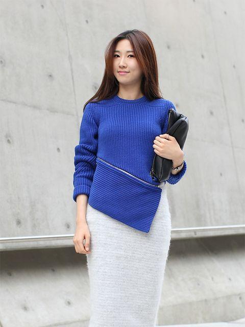 Suyeon wears Alexander Wang sweater, Zara skirt, Theory clutch.