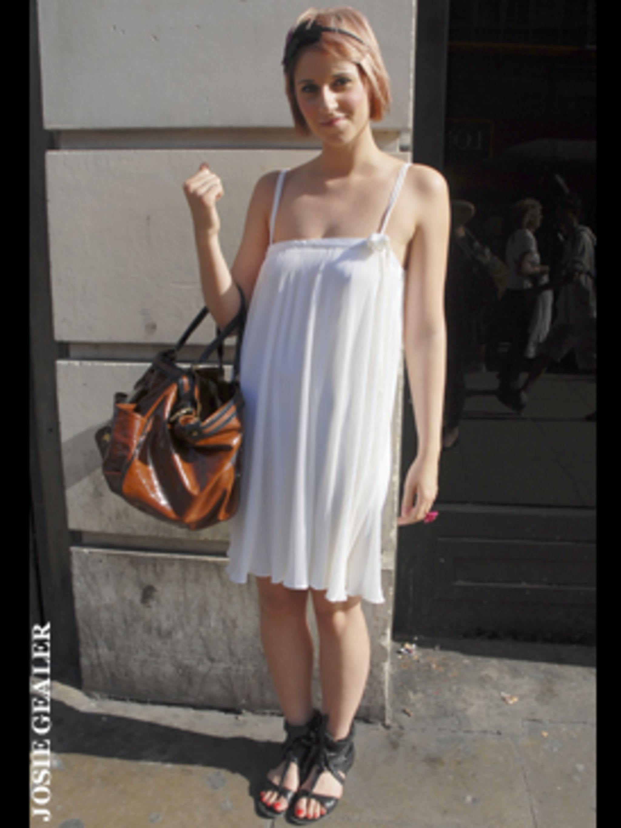 <p>Sammi knows that sometimes simple is best. She's opted for a gorgeous pleated dress and avoided looking like she's stepped out in a nightdress by choosing bold accessories to complete her look.</p>
