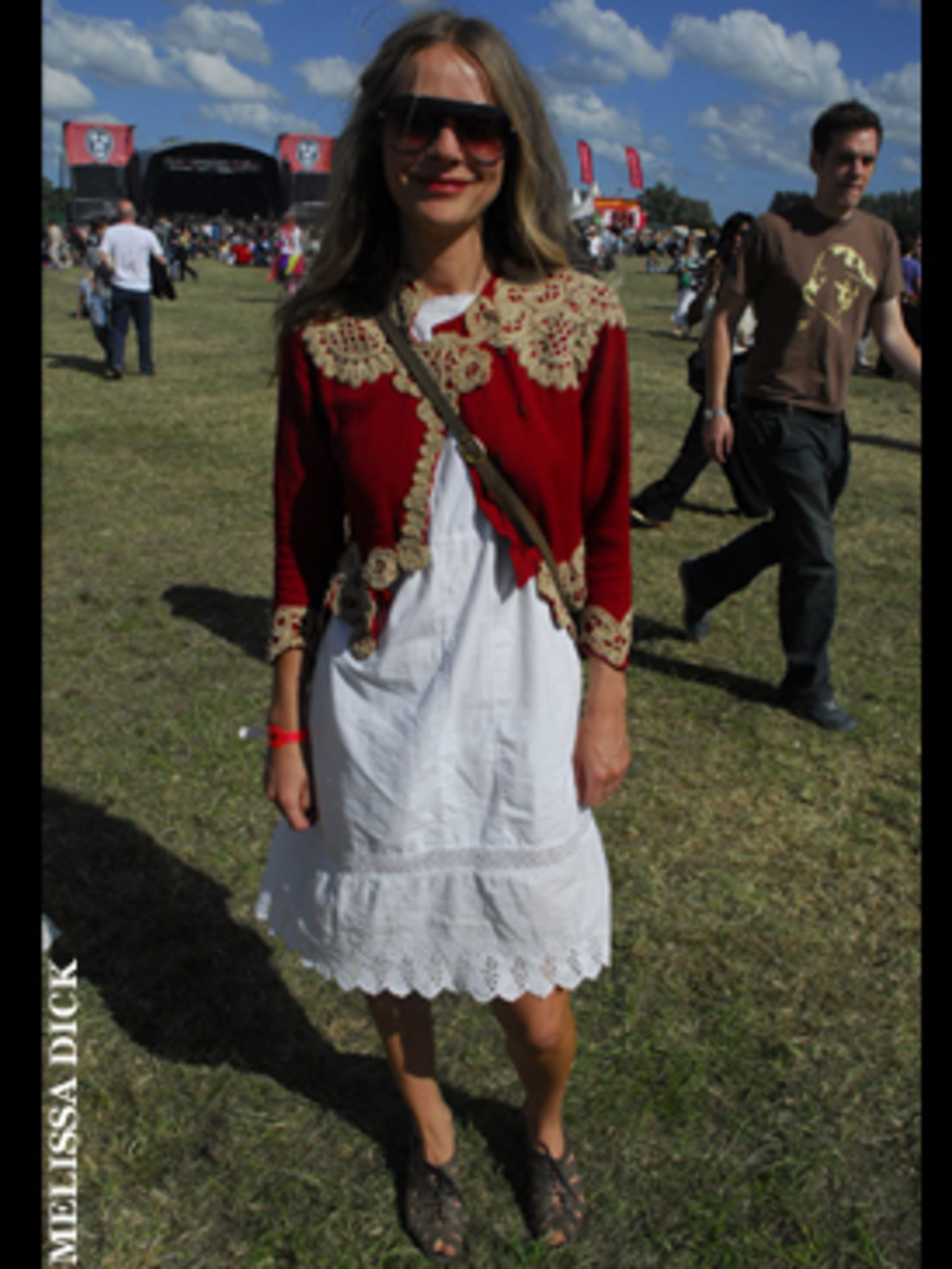 <p>This is the perfect festival look, teaming a pretty white frock with a cool vintage jacket - and if the rain starts to fall it will look just as stylish teamed with tights and wellies instead of sandals.</p>