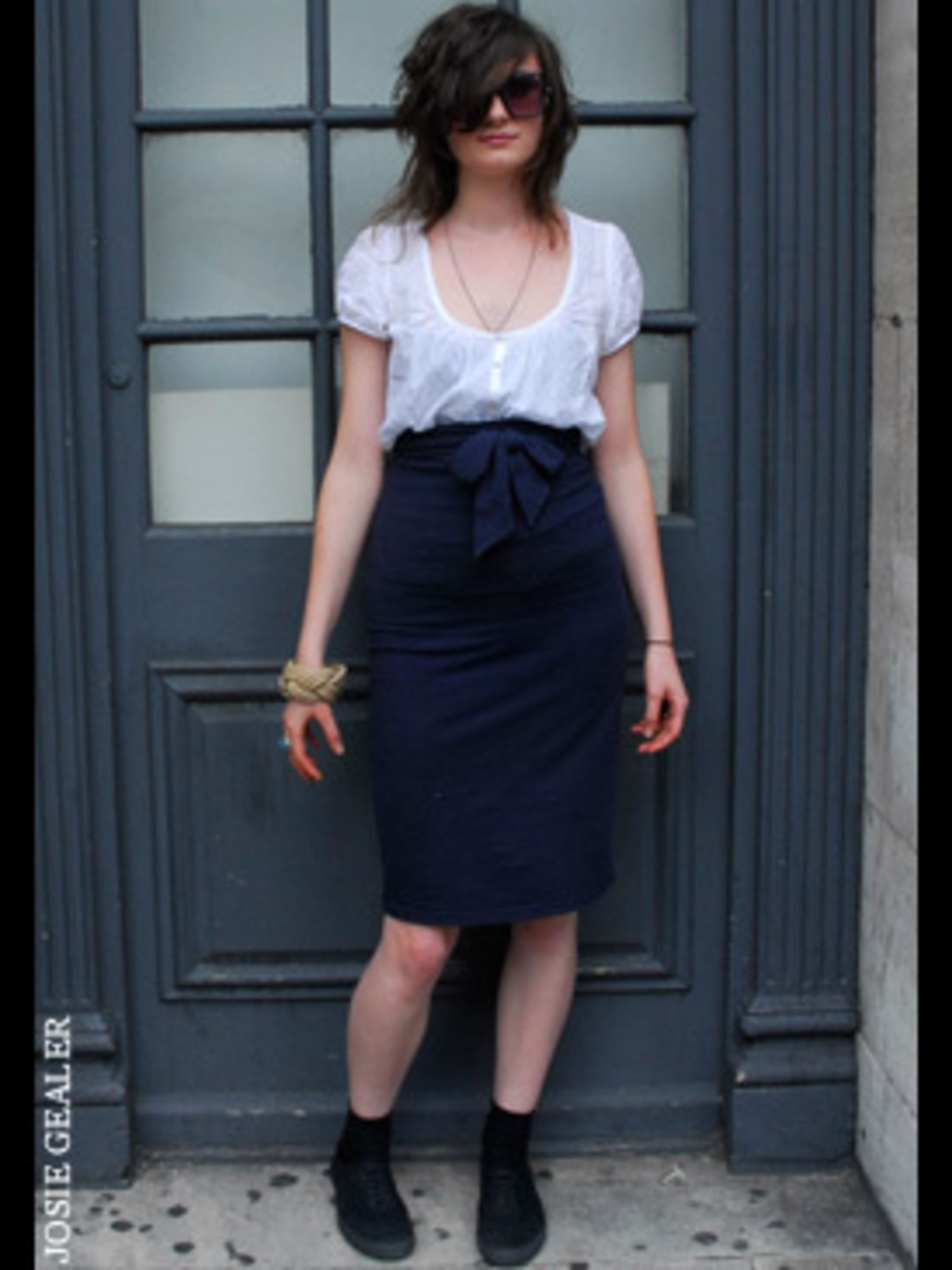 <p>Take a style tip from Elise who knows this simple white blouse is a great basic to team with a high waisted skirt. It lets the shape of the skirt take centre stage in this outfit. </p>