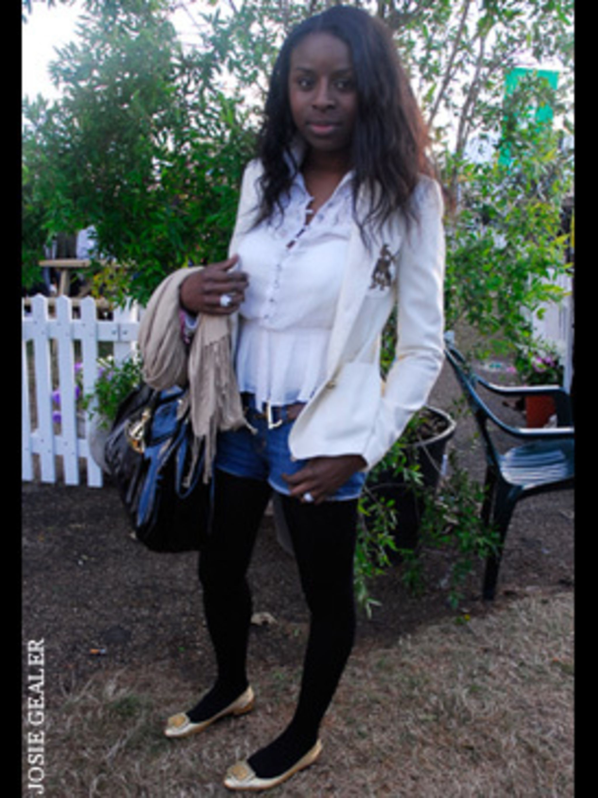 <p>A white shirt and blazer combo doesn't have to be just for the office - Conni has found the perfect weekend look by balancing out her smart shirt and tailored jacket with a pair of micro mini denim shorts.</p>