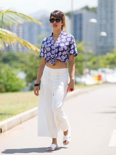 <p>Maria Callou wears: Sandro shirt, MiH culottes, Ancient Greek sandals.</p>