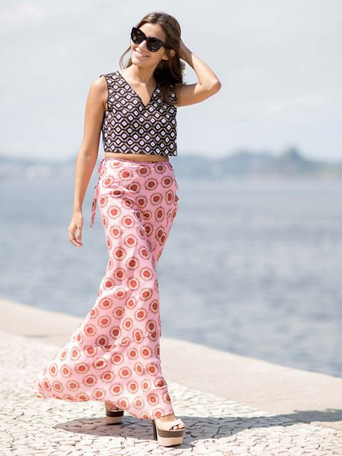 <p>Mirilla Mambo wears: Pinko top, Adriana Degreas skirt with Celine sunglasses.</p>