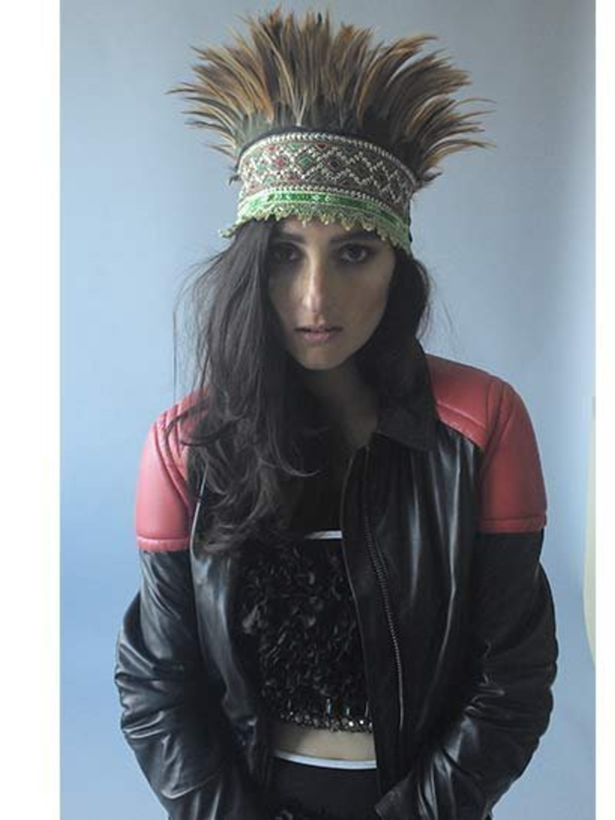 """<p>Banks wearing <a href=""""http://www.marni.com/home.asp?tskay=B84CE7A2"""">Marni</a> and a leather jacket by <a href=""""http://www.ganni.com/home/"""">Ganni</a>. </p>"""