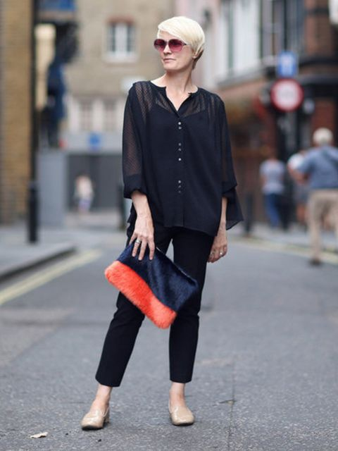 Lorraine Candy wears navy and orange faux fur Shrimps clutch, £185