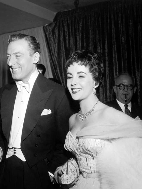 """<p><a href=""""http://www.elleuk.com/fashion/special-features/bridal-icons"""">Elizabeth Taylor</a> with her second husband, British actor Michael Wilding, at the Academy Awards in 1954</p>"""