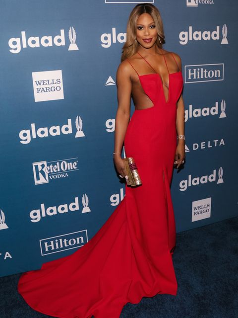 Laverne Cox's red dress is by Mikael D and her jewels are Forevermark.