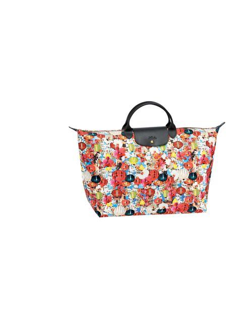 <p>Mary Katrantzou for Longchamp large travel bag, £160, for stockists call 0207 493 5515</p>