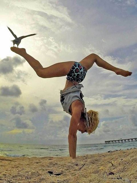 """<p><a href=""""https://instagram.com/beachyogagirl/"""">@beachyogagirl</a> aka Dream Lifestyle Yogi</p>  <p>Kerri Verna lives by the beach and posts daily, envy-inducing (not very yogi, we know. We're working on it) snaps of everything from acro yoga to handsta"""