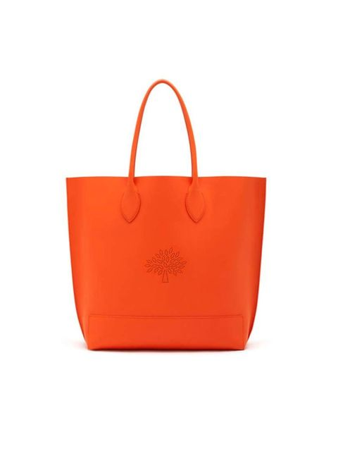 """<p>Give a winter palette of navy and charcoal grey a punch of colour.</p><p><a href=""""http://www.mulberry.com/shop/whats-new/whats-new-all/blossom-tote-mandarin-calf-nappa"""" target=""""_blank"""">Mulberry</a> tote, £495</p>"""