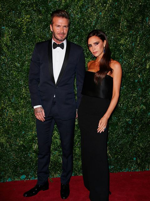David Beckham and Victoria Beckham wearing a gown from her collection to the Evening Standard Theatre Awards in London, November 2014.