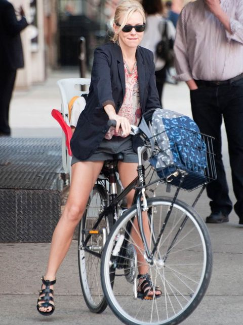"<p><a href=""http://www.elleuk.com/star-style/celebrity-style-files/naomi-watts2"">Naomi Watts</a> in a smart blazer, city sorts and leather sandals while riding her bicycle</p>"