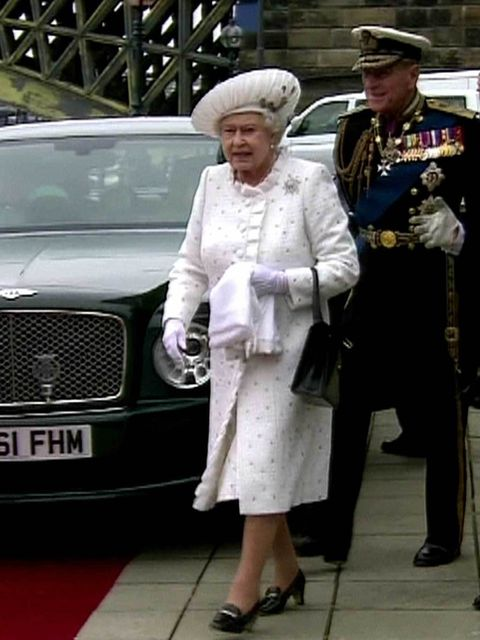 """<p><a href=""""http://www.elleuk.com/star-style/celebrity-style-files/the-queen-through-the-ages"""">The Queen</a> arriving in an Angela Kelly creation for the Royal Jubilee flotilla during the Jubilee celebrations</p>"""
