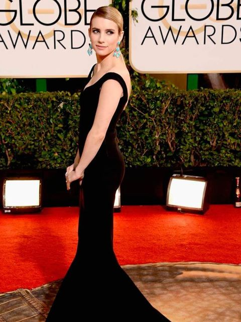 """<p><a href=""""http://www.elleuk.com/star-style/celebrity-style-files/emma-roberts"""">Emma Roberts'</a> Lanvin dress is the ultimate statement in modern black elegance. The cut shows her gym-toned body off perfectly and the fishtail hem is a statement of timel"""