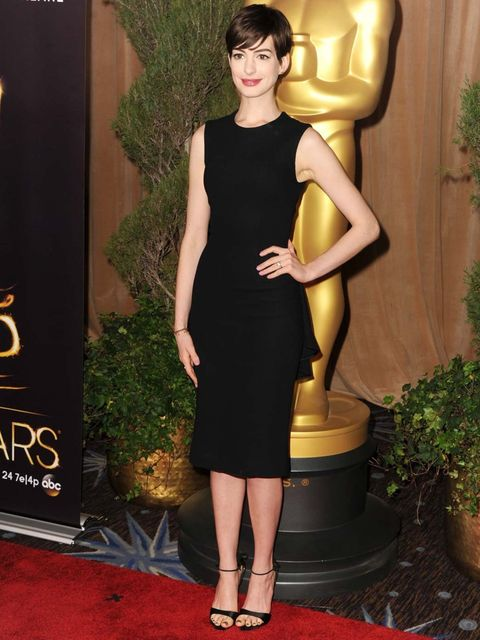 <p>Anne Hathaway kept it simple in a chic dress by The Row for the luncheon.</p>