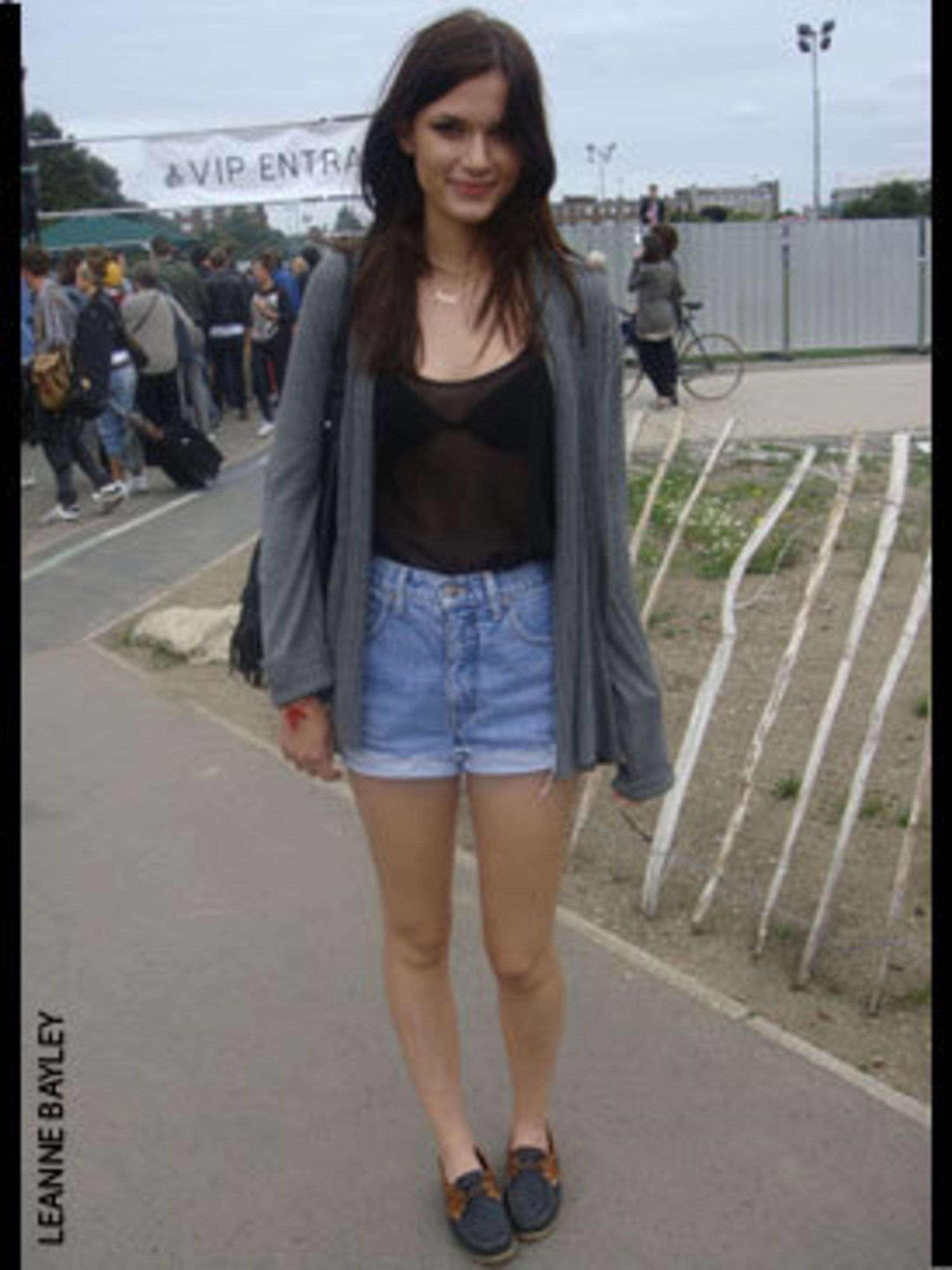 <p>Hannah Cassedy, 16, Student, wearing a cardigan and vest from H&amp&#x3B;M and shorts and shoes which are both vintage.</p>