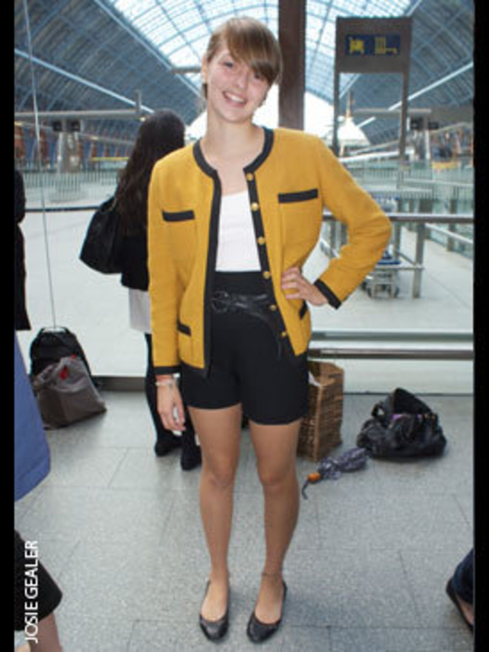 <p>Sarah Crawford, Student, wears vintage Chanel jacket, Moschino trousers, and Steve Madden shoes.</p>