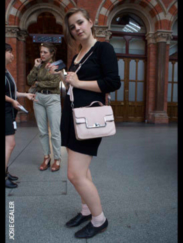 <p>Alex James, Fashion Intern, wears Topshop cardigan dress, Kurt Geiger shoes, and Marks & Spencer bag.</p>