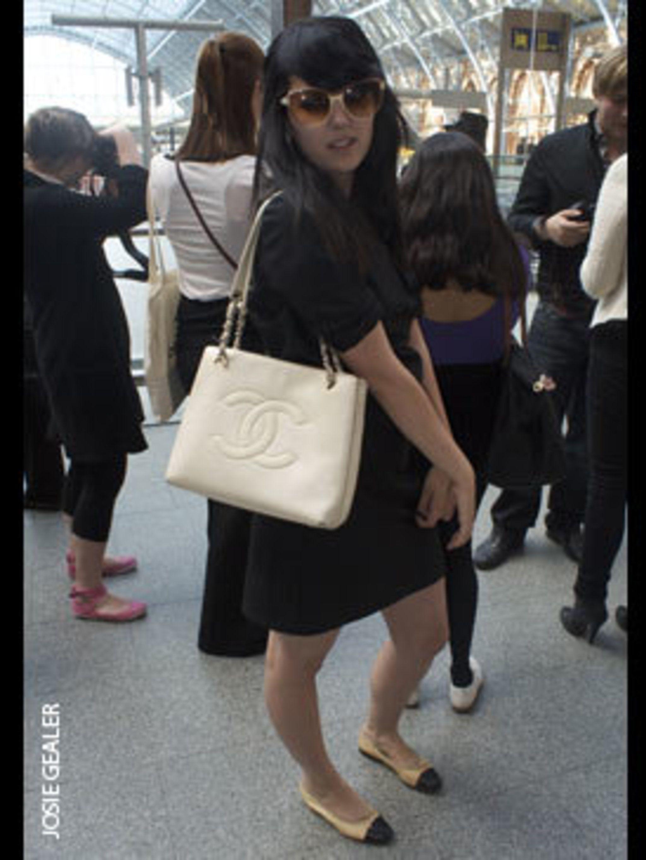<p>Alexandra Hicks, fur dealer, wears Gap dress, Fendi sunglasses, and Chanel bag and shoes.</p>