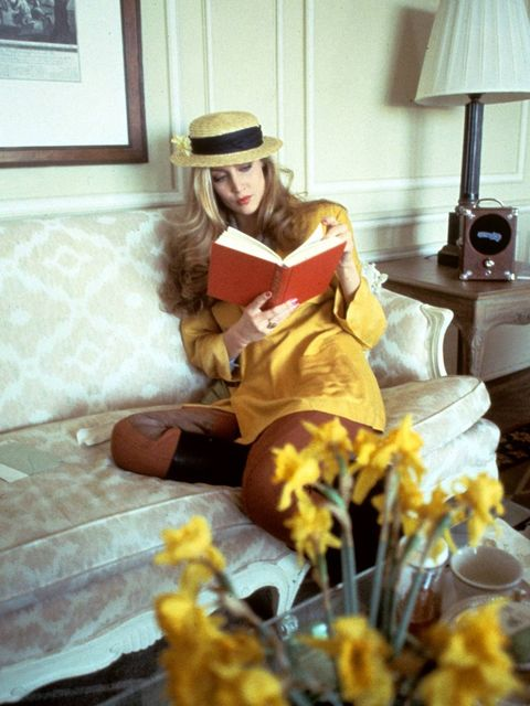 <p>Jerry Hall wears a yellow jacket teamed with a boater hat in 1978</p>