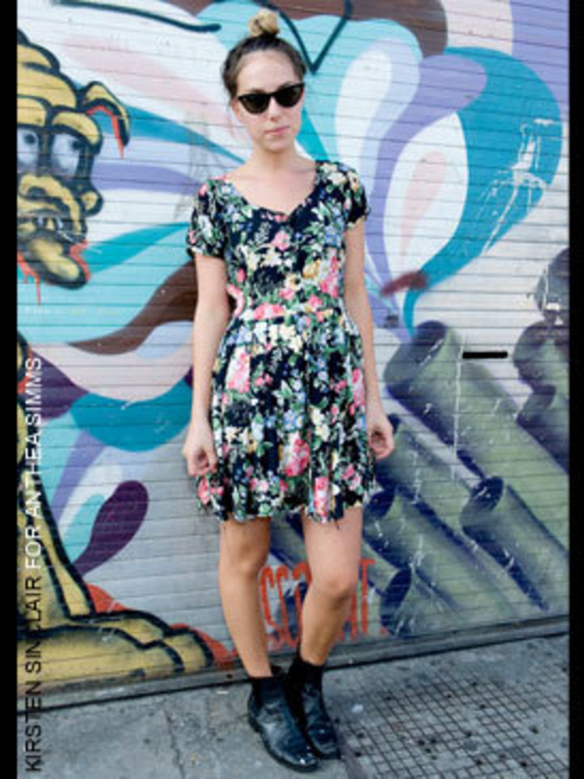 <p>Sarah a Bar Waitress from Sydney wearing sunglasses from The Vintage Store, dress from Battersea boot sale and Chelsea boots which are her mum's.</p>