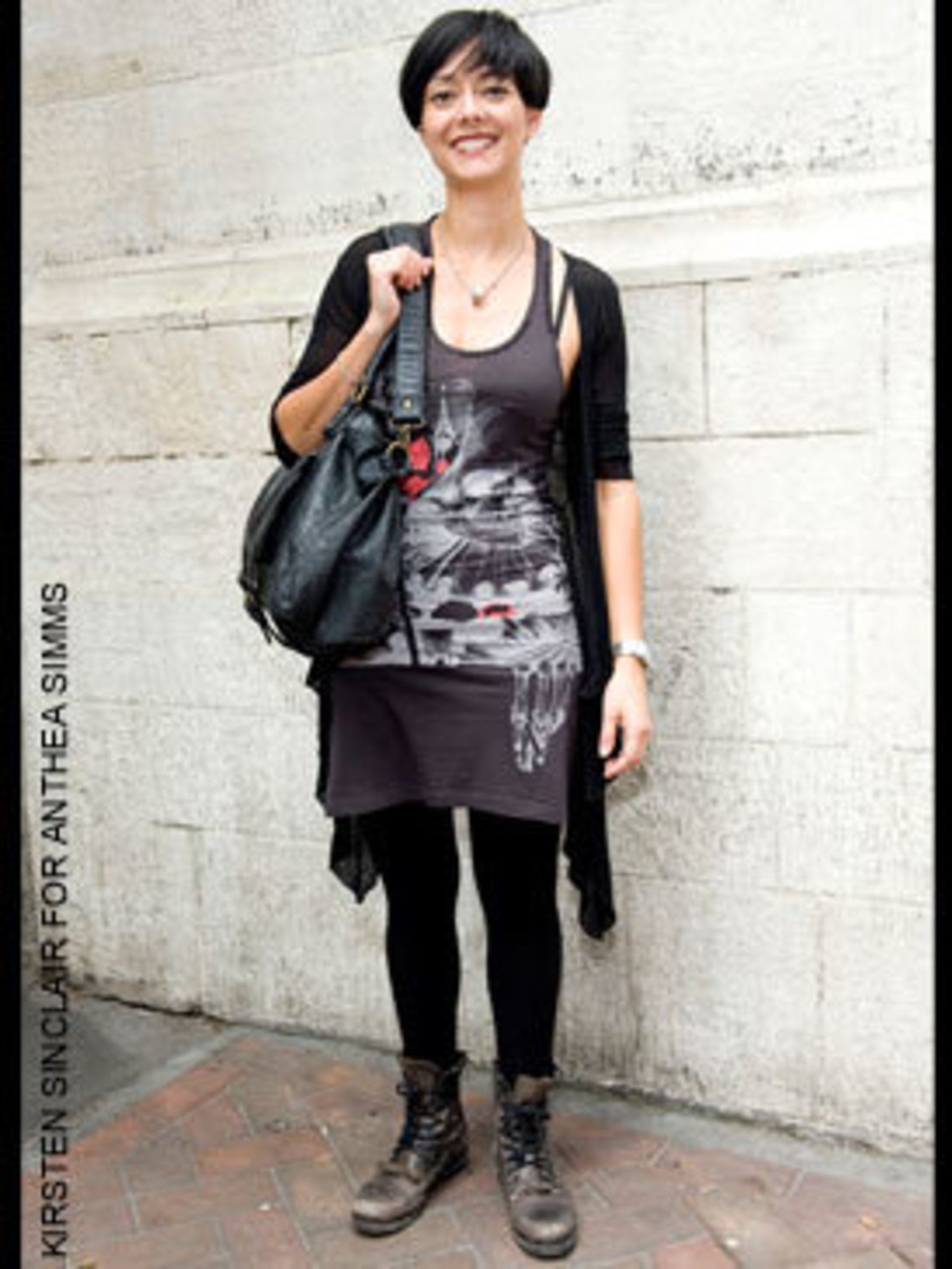 <p>Katherine a Hair stylist from london wearing a cardigan from Camden, vest dress from all saints, bag from Jolie Moie and boots from All Saints</p>