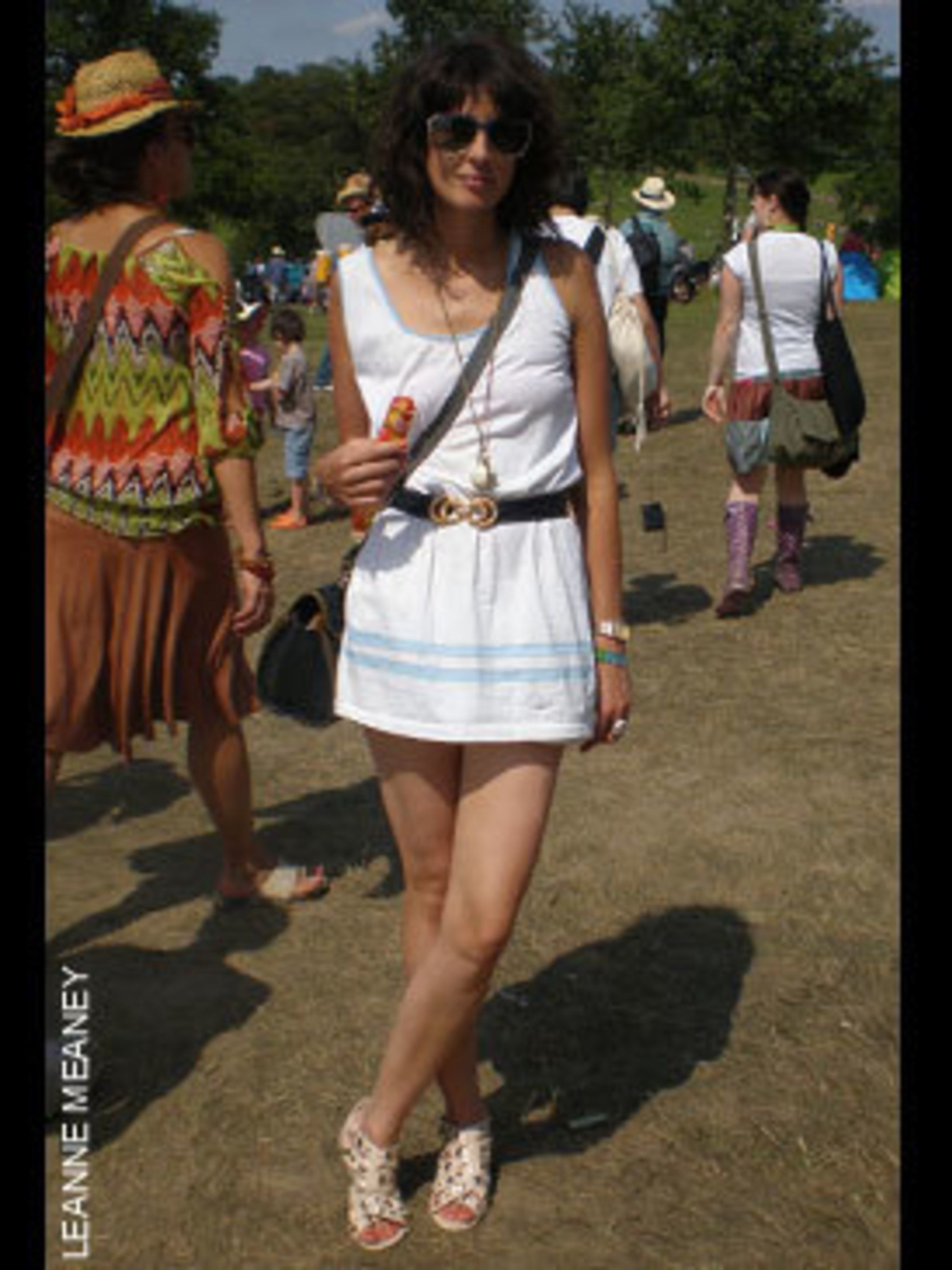 <p>Ceila, 30, Designer, Wearing a vintage dress and sandel's from Office.</p>