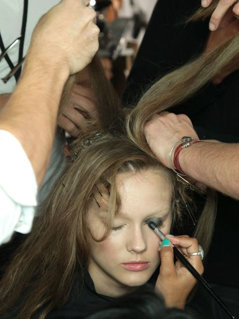 <p>This picture encapsulates the madness of being backstage, one model barely visible beneath the flaying arms of five hair stylists. Although the model may not be enjoying it much it's a heady, exciting and fast-paced atmosphere that I love being a part