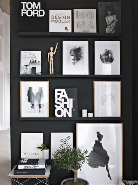 <p>Fashion bibles a-plenty? A simple black wall and a set of shallow floating shelves is all you need. </p>