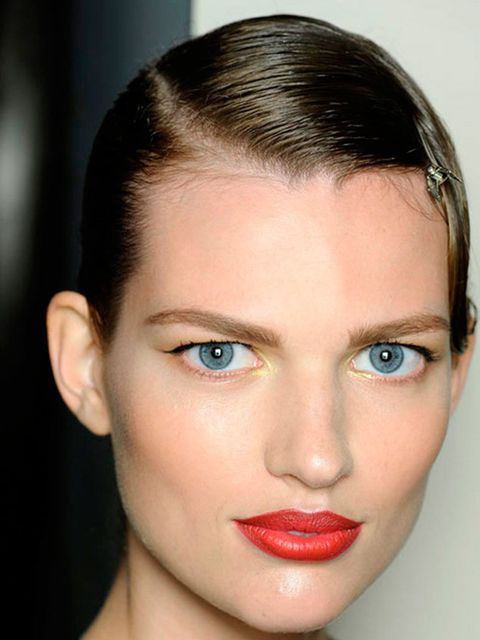 """<p><a href=""""http://www.elleuk.com/star-style/celebrity-beauty/celeb-make-up/best-celebrity-red-lips"""">A red lip</a> was one of the most iconic 1920s make-up looks. Think raspberry, rose, deep plum and orangey tones. Backstage at<a href=""""http://www.elleuk.c"""